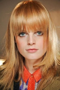 Light-copper-blonde-hair-color-for-long-layered-hair-with-bangs